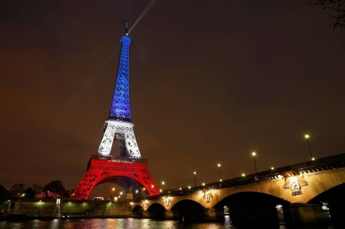 The Eiffel Tower is lit with the colors of the French flag in Paris on Nov. 16, 2015, to pay tribute to the victims of a series of deadly attacks on Friday in the French capital. BENOIT TESSIER / Reuters